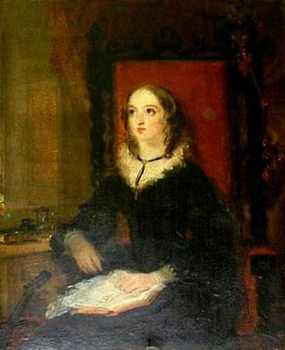 Woman In A Chair With Book On Lap